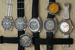 A pile of vintage Certina divers